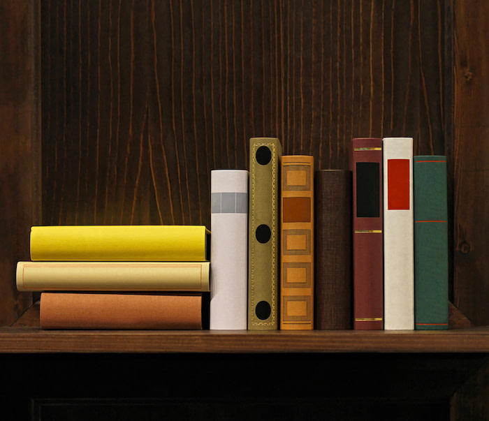 Dark wood book shelf with old books