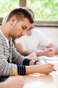 male college student sitting in a classroom
